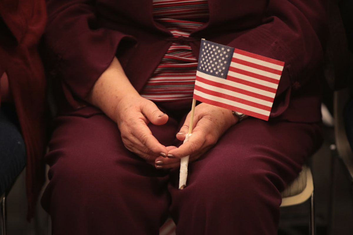 A women holding American Flag. (Getty Images)