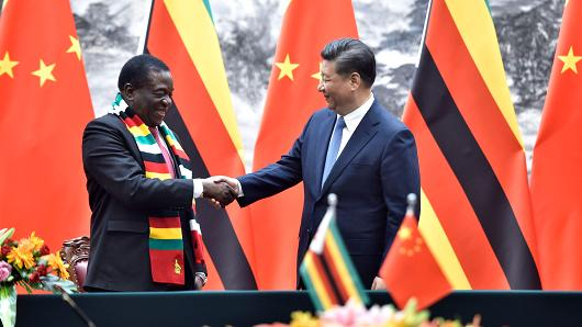 Zimbabwe President Emmerson Mnangagwa, left, shakes hands with Chinese President Xi Jinping as they pose for the media after a signing ceremony at the Great Hall of the People in Beijing, China, April 3, 2018. (AP)