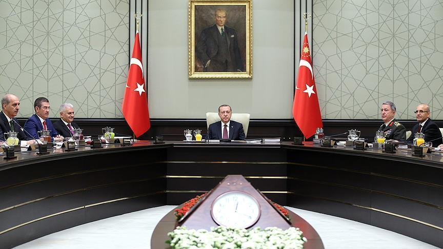 Turkey's President Recep Tayyip Erdogan (C) chairs the National Security Council that met to recommend prolonging the state of emergency by a further three months, in Ankara, Turkey, January 17, 2018. (AP)