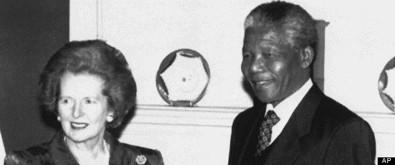 In this picture taken July 4, 1990, British Prime Minister Margaret Thatcher, left, shakes hands with former ANC deputy leader Nelson Mandela inside 10 Downing Street, London, prior to talks and a luncheon. (AP)